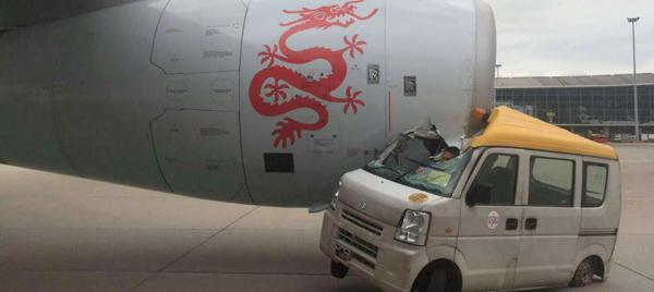 A van hits a plane of Dragon Air